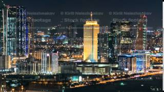Scenic Dubai downtown skyline timelapse at night. Rooftop view of Sheikh Zayed road with numerous