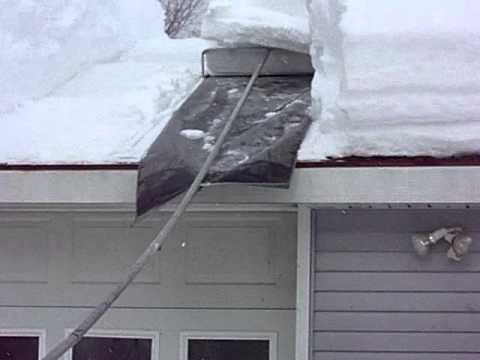 Snow Removal Roof 1 22 2011.MOV   YouTube