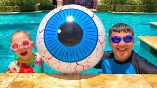 Nastya ve babası çocuklar için, havuzda nasıl yüzüleceği hakkındaşarkı söylüyorlar.