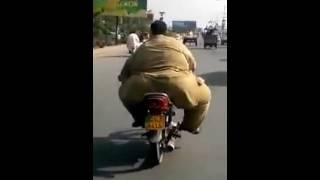 pahelwaan fat guy on small bike in pakistan
