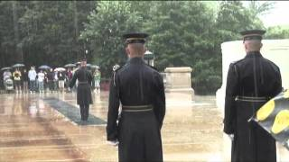 changing of the guard at tomb of unknown during thunder storm.