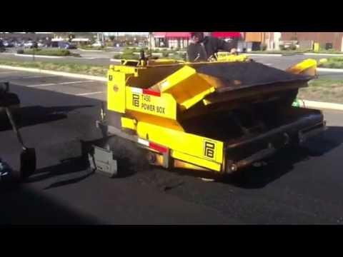 Mini Asphalt Paver In Action Doing A Sidewalk Mini Pa