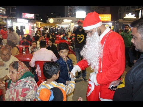 Celebration with special children by unique artist foundation,Spread smile-love by Santa Claus 2018