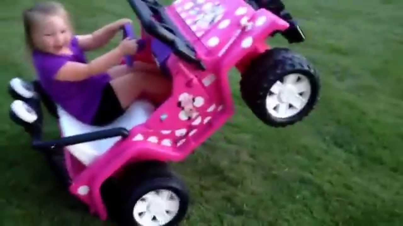3 year old riding wheelies in her power wheels jeep