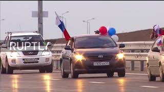 Russia: Honking and flag waving as Crimean Bridge opens to public