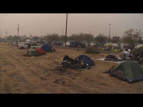 AFP news agency: California wildfire evacuees set up improvised camp