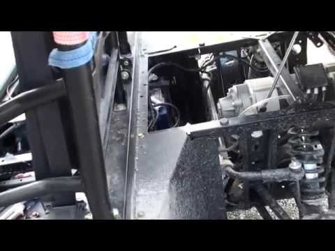 how to change battery in 2011 polaris 4x4