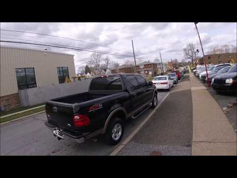 2002 Black /Tan Ford F-150 Lariat SuperCrew Short Bed 4WD (1FTRW08L12K) with an 5.4L V8 SOHC 16V engine, 4-Speed Automatic Overdrive transmission, located at 577 Chester Pike, Prospect Park, PA, 19076, (610) 237-1015, 39.886154, -75.302338 - Photo #0