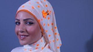 طريقة عمل لفة مع الحجاب البرتقالي المنقّط