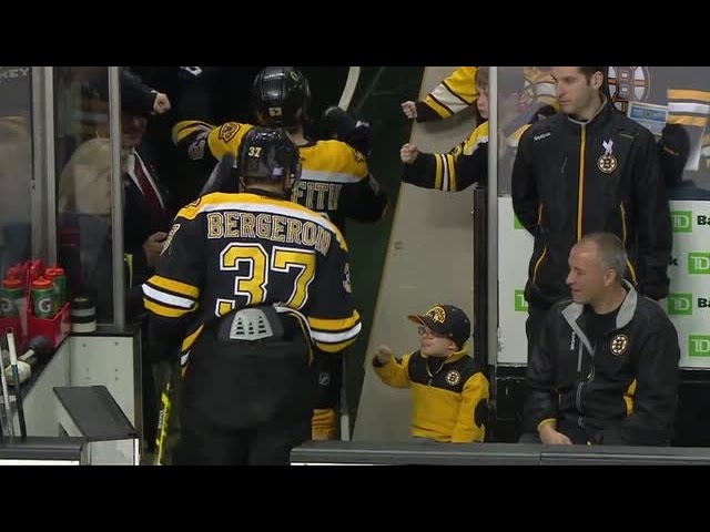 Young Bruins Fan Fist Bumps His Favorite Team