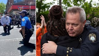 video: 'These cops love you': US police officers join George Floyd protests against police brutality
