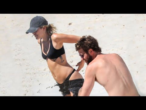 Miley Cyrus and Liam Hemsworth Heat Things Up on the Beach -- See the Pics! Mp3
