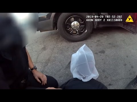 This is police body cam video of Sacramento officers putting a spit mask on a juvenile