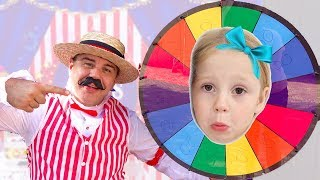 Stacy y papá juegan en un parque de diversiones