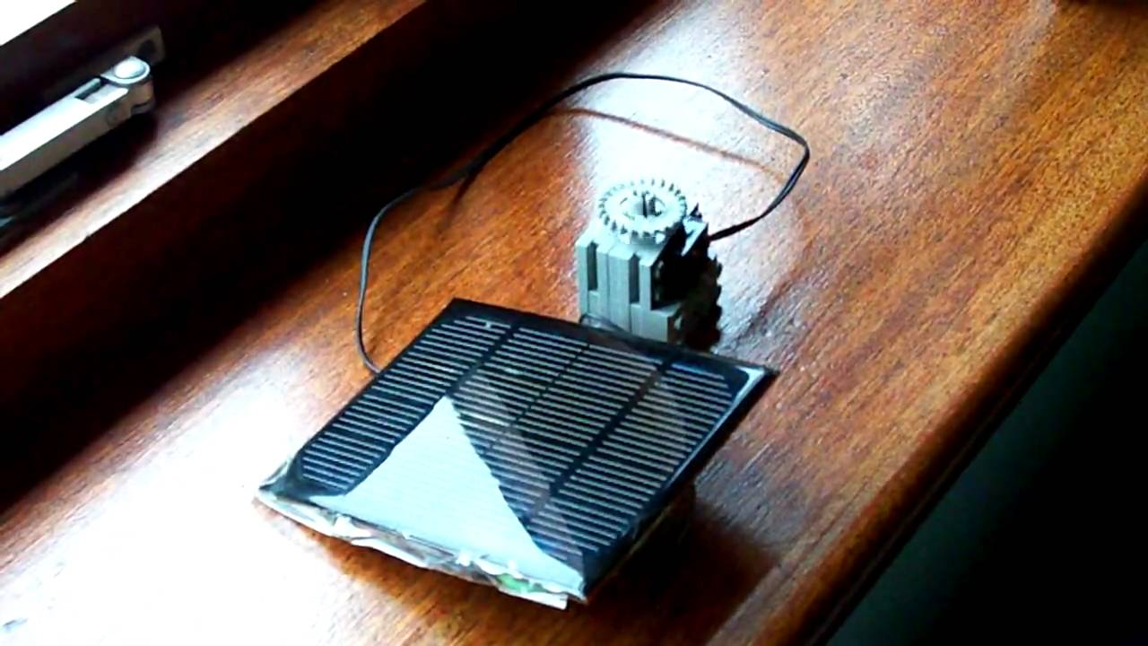 Small Solar Panel Powering A Lego Motor On A Cloudy Day