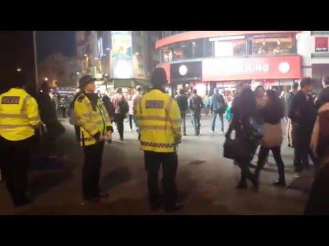 Human beat box make police dance London Trafalgar square UK