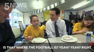 Children play piggy in the middle with the Chancellor