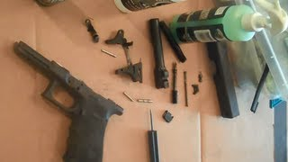 Cleaning a disassembled Glock with FrogLube