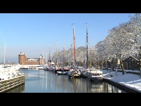 Winter in Muiden. Ice skating & Amsterdam castle. Waterfront living Schoutenwerf, The Netherlands.
