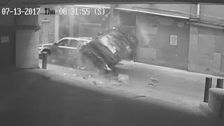 Woman survives as her car plunges seven stories thumbnail