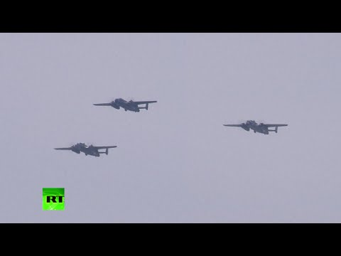 Vintage fighters, bombers fly over Washington in WW2 commemoration
