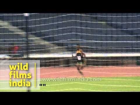 Athletes running round on race-track at Nehru stadium - Delhi