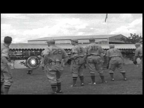 The Cincinnati Reds baseball team disembark from a flying boat and practice on a ...HD Stock Footage