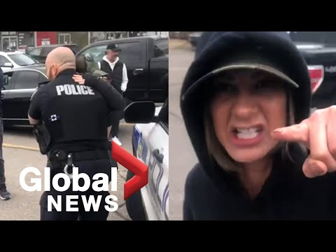 Officer in Ontario suspended after hugging COVID-19 protesters