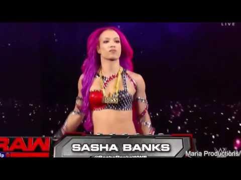 Sasha Banks enters the arena with Edge's theme song