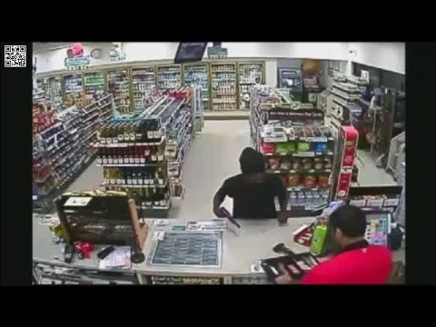 Armed robbery suspect caught on surveillance robbing 7-Eleven in Tampa