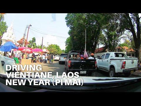 Driving - Vientiane, Laos during Pi Mai | City, Temple, Traffic Jam, Local Radio