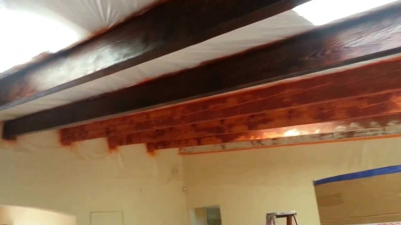 Finish Coat Of Stain On Wooden Beams In Living Room