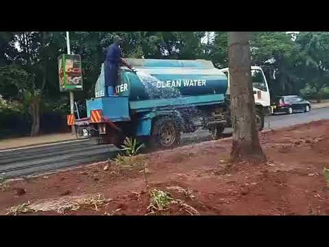 Making Nairobi Beautiful and Green My Environment Team Watering the flowers2