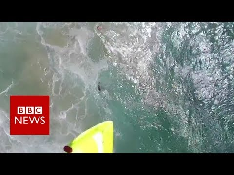 Swimmers rescued by drone in Australia - BBC News