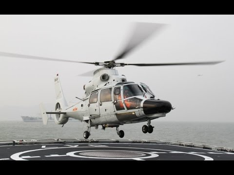 Chinese Military Helicopter LANDS ON US NAVY Warship