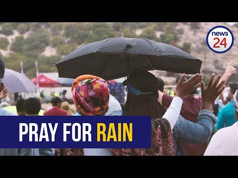 WATCH: Huge group gathers for Buchan as he prays for rain and saves gang leaders