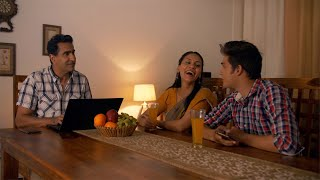 Happy Indian family sitting on the dining table - Spending time together. Family Concept