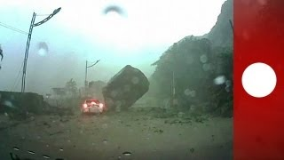 Amazing escape: Car caught in landslide, almost smashed by huge rock during Taiwan storm