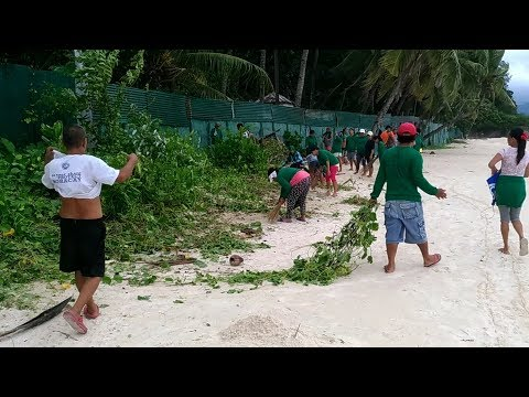 Boracay Island Workers Cleaning up Station 3 Front Beach brought on by Monsoon Season