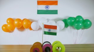 Tricolor Charkhis rolling on a wooden table on Independence/Republic day in India