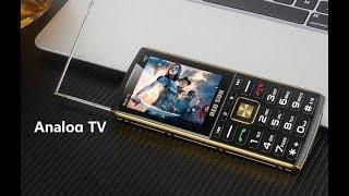 Видео обзор телефона на 4 СИМ карты с телевизором!