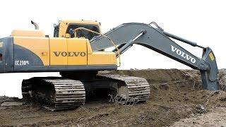 Excavator Digging Dirt Loading Dump Truck Volvo EC210B
