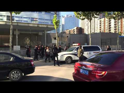 China police remove anti-US protester from US Embassy
