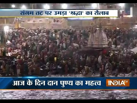 Devotees takes a holy bath in river Ganges on the occasion of Mauni Amavasya