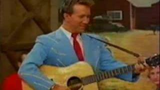 Watch Marty Robbins All The World Is Lonely Now video