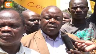 Sugarcane farmers protest outside the Busia law courts