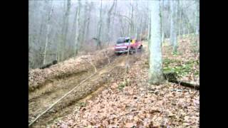 Big Chevy saving broken Ford on jeep trail
