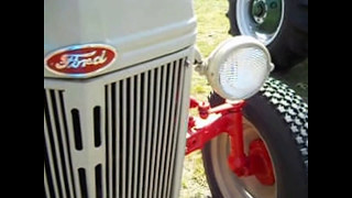 Collection Line Of Antique Ford Tractors
