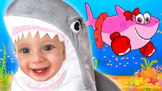 Maya and Mary in shark costumes sing the Kids Song Baby Shark