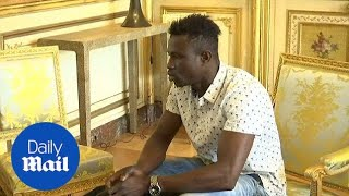 French President Emmanuel Macron meets with Malian migrant hero
